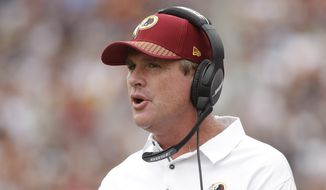 Washington Redskins head coach Jay Gruden watches during the first half of an NFL football game against the Los Angeles Rams Sunday, Sept. 17, 2017, in Los Angeles. (AP Photo/Jae C. Hong)
