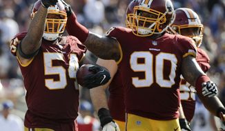 Washington Redskins inside linebacker Mason Foster, left, celebrates after intercepting a pass woth Ziggy Hood during the second half of an NFL football game against the Los Angeles Rams Sunday, Sept. 17, 2017, in Los Angeles. (AP Photo/Jae C. Hong)