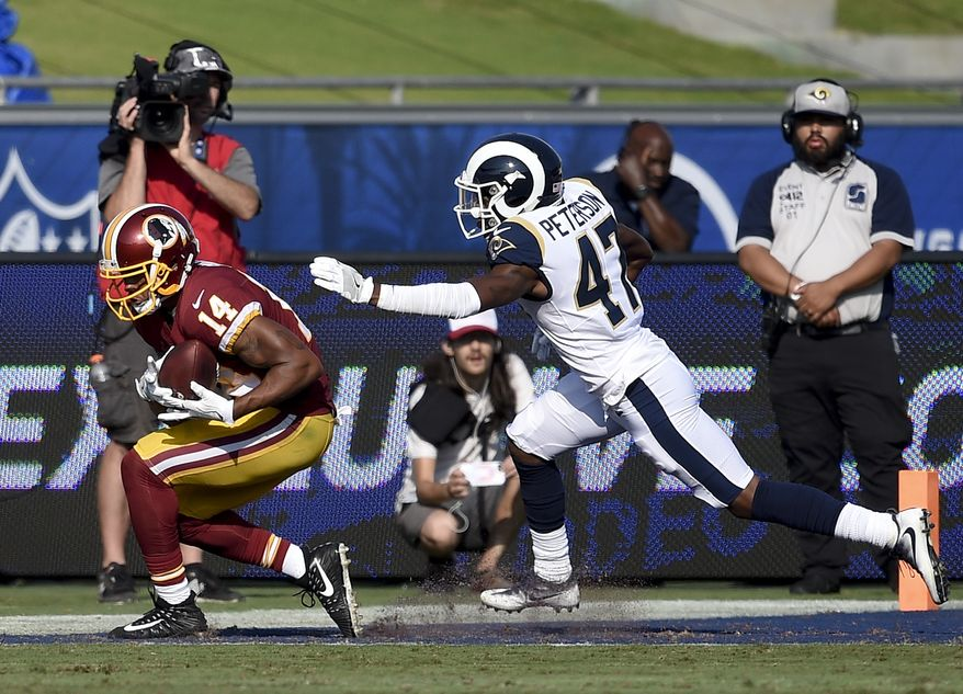 Washington Redskins wide receiver Ryan Grant catches a touchdown pass ahead of a Los Angeles Rams Kevin Peterson during the second half of an NFL football game Sunday, Sept. 17, 2017, in Los Angeles. (AP Photo/Kelvin Kuo)