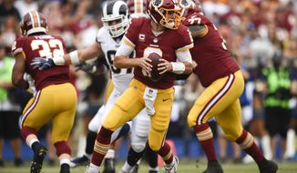 Washington Redskins quarterback Kirk Cousins plays during the first half of an NFL football game against the Los Angeles Rams Sunday, Sept. 17, 2017, in Los Angeles. (AP Photo/Kelvin Kuo)