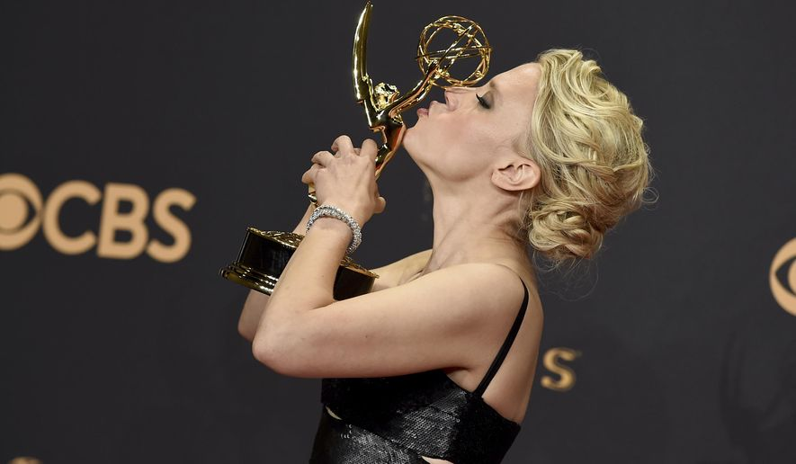"""Kate McKinnon poses in the press room with the award for outstanding supporting actress in a comedy series for """"Saturday Night Live"""" at the 69th Primetime Emmy Awards on Sunday, Sept. 17, 2017, at the Microsoft Theater in Los Angeles. (Photo by Jordan Strauss/Invision/AP)"""