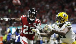 Green Bay Packers wide receiver Davante Adams (17) prepares to make a touchdown catch against Atlanta Falcons cornerback Robert Alford (23) during the second of an NFL football game, Sunday, Sept. 17, 2017, in Atlanta. (AP Photo/David Goldman)
