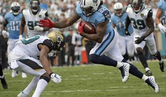 Jacksonville Jaguars cornerback Jalen Ramsey, left, tries but can't stop Tennessee Titans running back Derrick Henry (22) from getting in the end zone to complete a 17-yard touchdown run during the second half of an NFL football game, Sunday, Sept. 17, 2017, in Jacksonville, Fla. (AP Photo/Phelan M. Ebenhack)