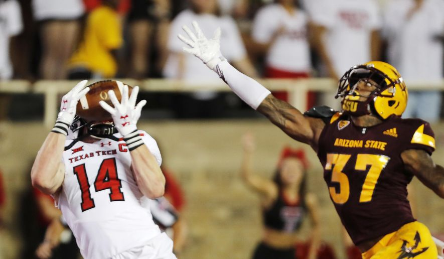 Texas Tech receiver Dylan Cantrell makes a touchdown reception while defended by Arizona State's Joseph Bryant during the first half of an NCAA college football game Saturday, Sept. 16, 2017, in Lubbock, Texas. (Mark Rogers/Lubbock Avalanche-Journal via AP)