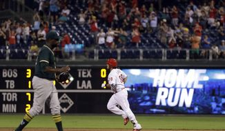 Philadelphia Phillies' Jorge Alfaro, right, rounds the bases after hitting a two-run home run off Oakland Athletics relief pitcher Simon Castro during the sixth inning of a baseball game, Saturday, Sept. 16, 2017, in Philadelphia. Philadelphia won 5-3. (AP Photo/Matt Slocum)