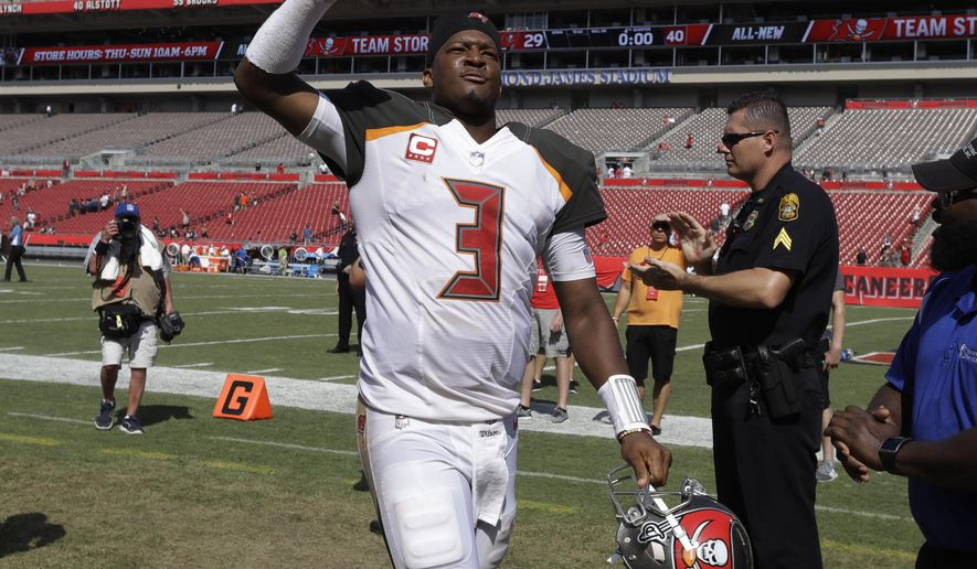 Tampa Bay Buccaneers quarterback Jameis Winston (3) raises his fist as he leaves the field, at the end an NFL football game against the Chicago Bears, Sunday, Sept. 17, 2017, in Tampa, Fla. The Bucs defeated the Bears 29-7. (AP Photo/Chris O'Meara)