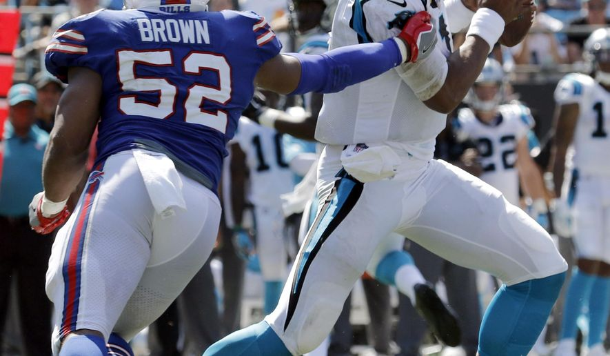 Carolina Panthers' Cam Newton (1) tries to avoid Buffalo Bills' Preston Brown (52) in the second half of an NFL football game in Charlotte, N.C., Sunday, Sept. 17, 2017. (AP Photo/Bob Leverone)