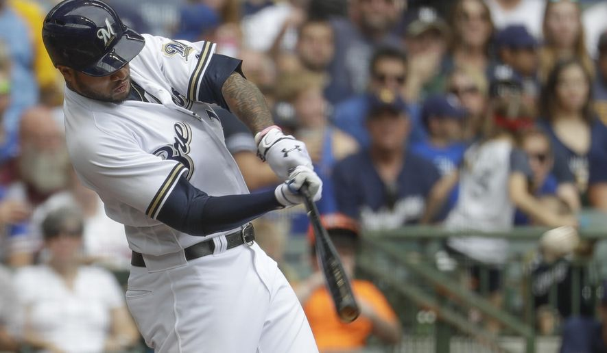 Milwaukee Brewers' Domingo Santana hits a three-run scoring double during the fourth inning of a baseball game against the Miami Marlins Sunday, Sept. 17, 2017, in Milwaukee. (AP Photo/Morry Gash)