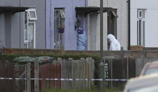 "Police forensic officers enter a property in Sunbury-on-Thames, southwest London, as part of the investigation into Friday's Parsons Green bombing, Saturday Sept, 16, 2017.  British police made what they called a ""significant"" arrest Saturday in southern England, and searched a property in Sunbury-on-Thames as the manhunt for suspects continues following the partially exploded bomb attack on the London subway. ( Jonathan Brady/PA via AP)"