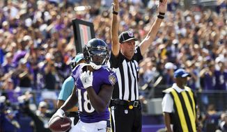 Baltimore Ravens wide receiver Jeremy Maclin (18) looks over his shoulder after scoring a touchdown during the first half of an NFL football game against the Cleveland Browns in Baltimore, Sunday, Sept. 17, 2017. (AP Photo/Nick Wass)