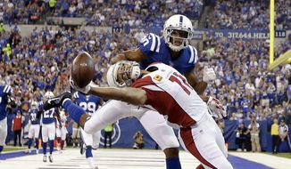 Arizona Cardinals' Larry Fitzgerald (11) tries to make a catch while being defended by Indianapolis Colts' Rashaan Melvin during the first half of an NFL football game Sunday, Sept. 17, 2017, in Indianapolis. The pass was incomplete. (AP Photo/AJ Mast)