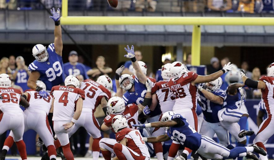 Arizona Cardinals' Phil Dawson (4) kicks a game winning 30-yard field goal out of the hold of Andy Lee (2) in overtime of an NFL football game against the Indianapolis Colts, Sunday, Sept. 17, 2017, in Indianapolis. (AP Photo/Darron Cummings)