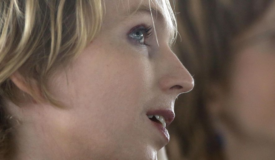 Chelsea Manning looks up before going on stage Sunday, Sept. 17, 2017 for an appearance at a forum, in Nantucket, Mass. The forum was part of The Nantucket Project's annual gathering on the island of Nantucket. Manning is a former U.S. Army intelligence analyst who spent time in prison for sharing classified documents. (AP Photo/Steven Senne)