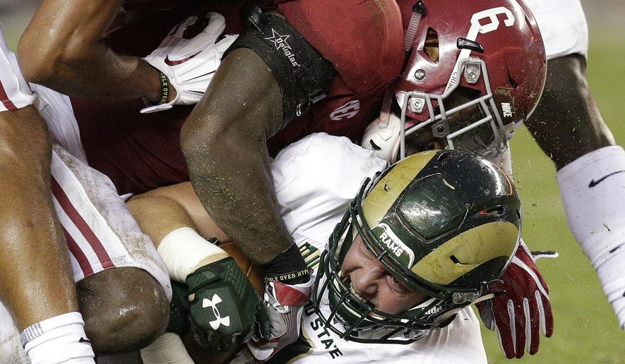 Colorado State tight end Dalton Fackrell is tackled by Alabama defensive back Hootie Jones during the first half of an NCAA college football game, Saturday, Sept. 16, 2017, in Tuscaloosa, Ala. (AP Photo/Brynn Anderson)