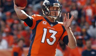 Denver Broncos quarterback Trevor Siemian (13) throws against the Dallas Cowboys during the first half of an NFL football game, Sunday, Sept. 17, 2017, in Denver. (AP Photo/Joe Mahoney)