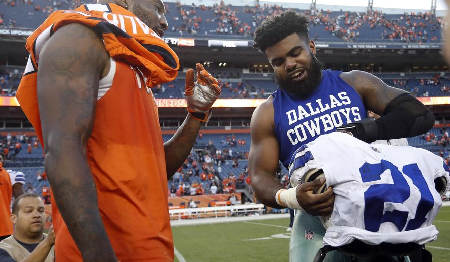 Dallas Cowboys running back Ezekiel Elliott, right, and Denver Broncos cornerback Aqib Talib exchange jerseys after an NFL football game, Sunday, Sept. 17, 2017, in Denver. The Broncos won 42-17. (AP Photo/Joe Mahoney)