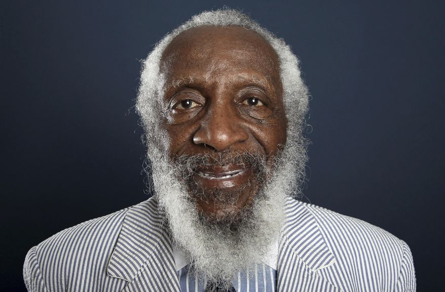FILE - In this July 21, 2012 file photo, comedian and activist Dick Gregory poses for a portrait during the PBS TCA Press Tour in Beverly Hills, Calif. Friends and family of Gregory have gathered at a Maryland church in the suburbs of the nation's capital to celebrate the life of the comedian and activist. The service was held Saturday, Sept. 16, 2017, at City of Praise Family Ministries in Landover, Md.  (Photo by Matt Sayles/Invision/AP, File)