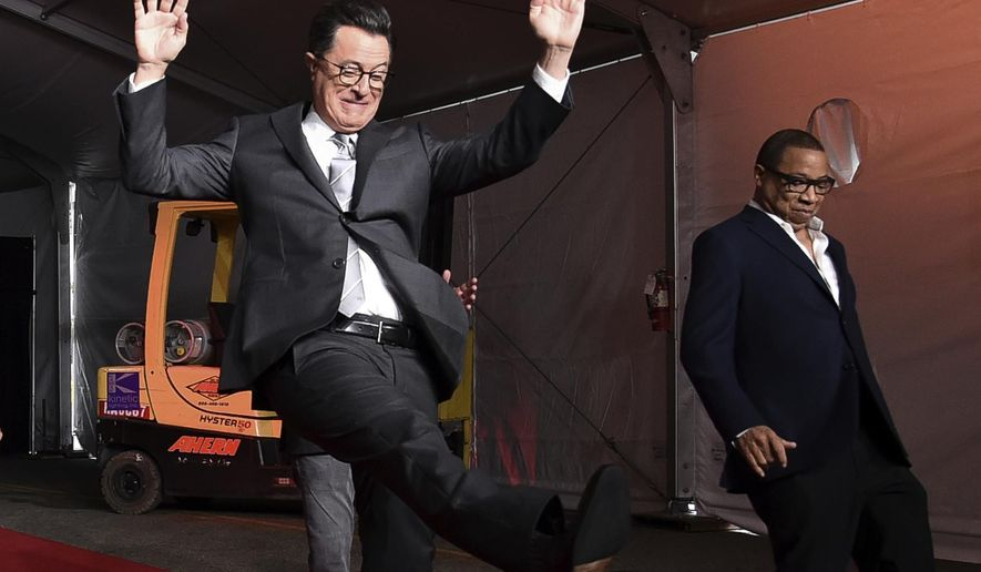 FILE - In this Tuesday, Sept. 12, 2017, file photo, Stephen Colbert, left, and Hayma Washington participate in the 2017 Primetime Emmy Red Carpet Rollout at the Microsoft Theater in Los Angeles. The Emmys will be held on Sunday. (Photo by Richard Shotwell/Invision/AP, File)