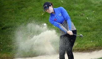 Brittany Altomare, of USA, follows her ball after playing from the sand on the 16th hole during the final round of the Evian Championship women's golf tournament in Evian, eastern France, Sunday, Sept. 17, 2017. (AP Photo/Laurent Cipriani)