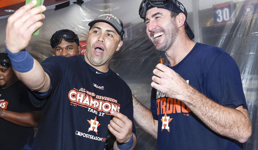 Houston Astros' Justin Verlander, right, and Carlos Beltran celebrate the team's win over the Seattle Mariners and the clinching of the AL West crown in a baseball game, Sunday, Sept. 17, 2017, in Houston. (AP Photo/Eric Christian Smith)