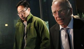 FILE - In this Friday, Dec. 19, 2014, file photo the former supervisory pharmacist for the New England Compounding Center, Glenn Chin, left, leaves the federal courthouse in Boston with his attorney Stephen Weymouth after a hearing to announce conditions of his bail and release. Chin who was the supervisory pharmacist at the now-closed New England Compounding Center in Framingham is heading to trial with opening arguments in the case are expected on Tuesday, Sept. 19, 2017. He faces up to life in prison if convicted of all counts of second-degree murder under federal racketeering law. (AP Photo/Elise Amendola, File)