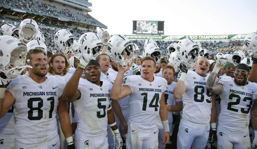 FILE - ADVANCE FOR USE SUNDAY, SEPT. 17 - In this Saturday, Sept. 9, 2017, file photo, Michigan State players, including Matt Sokol (81), Andrew Dowell (5), Brian Lewerke (14), Matt Dotson (89) and Chris Frey (23), celebrate following a 28-14 win over Western Michigan in an NCAA college football game in East Lansing, Mich. Michigan State knows better than to get too carried away after a 2-0 start. The Spartans won their first two games last season but finished 3-9. (AP Photo/Al Goldis)