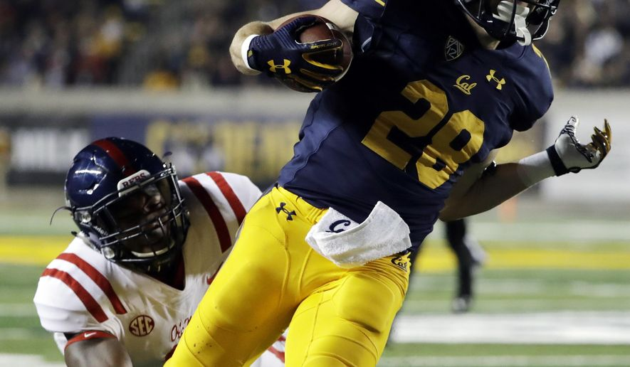 California running back Patrick Laird (28) scores a rushing touchdown past Mississippi linebacker DeMarquis Gates during the first half of an NCAA college football game Saturday, Sept. 16, 2017, in Berkeley, Calif. (AP Photo/Marcio Jose Sanchez)