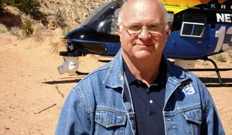 An undated photo provided by KRQE TV shows longtime reporter-videographer Bob Martin. Martin died Saturday night, Sept. 16, 2017, after the news helicopter he was piloting crashed in central New Mexico, authorities said Sunday. He was pronounced dead at the crash scene Saturday night, according to New Mexico State Police.  (KRQE TV via AP)