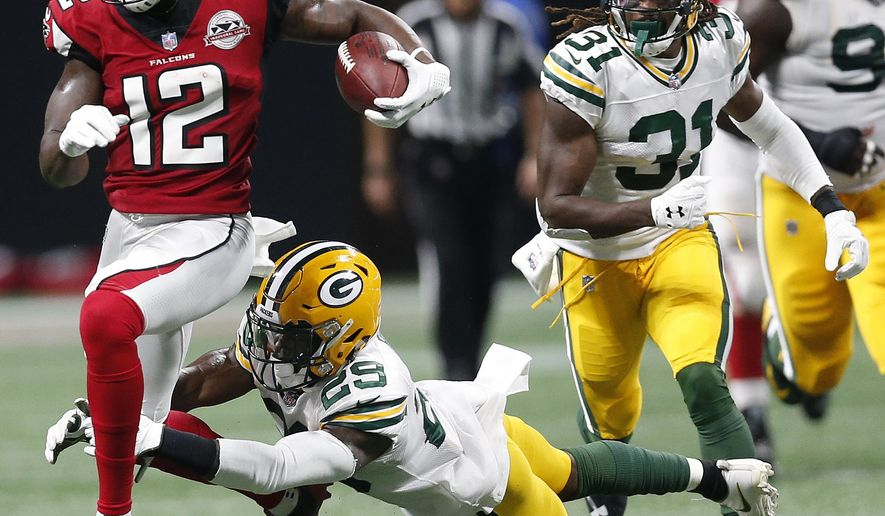 Atlanta Falcons wide receiver Mohamed Sanu (12) runs by Green Bay Packers defensive back Kentrell Brice (29) during the first of an NFL football game, Sunday, Sept. 17, 2017, in Atlanta. (AP Photo/John Bazemore)