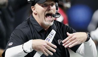 Atlanta Falcons head coach Dan Quinn speaks to players during the first of an NFL football game against the Atlanta Falcons, Sunday, Sept. 17, 2017, in Atlanta. (AP Photo/John Bazemore)