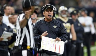 New Orleans Saints head coach Sean Payton talks on the sideline in the first half of an NFL football game against the New England Patriots in New Orleans, Sunday, Sept. 17, 2017. (AP Photo/Bill Feig)