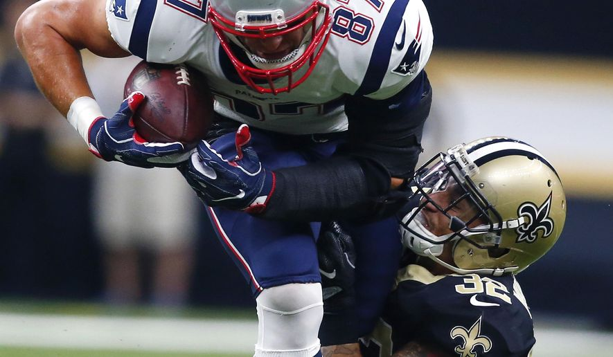 New England Patriots tight end Rob Gronkowski (87) carries against New Orleans Saints strong safety Kenny Vaccaro (32) in the first half of an NFL football game in New Orleans, Sunday, Sept. 17, 2017. (AP Photo/Butch Dill)