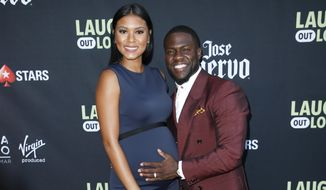 "In this Aug. 3, 2017, file photo, comedian Kevin Hart and his wife Eniko Parrish pose at Kevin Hart's ""Laugh Out Loud"" new streaming video network launch event at the Goldstein Residence on in Beverly Hills, Calif. (Photo by Danny Moloshok/Invision/AP, File)"