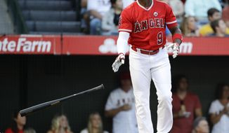 Los Angeles Angels' Justin Upton watches his home run against the Texas Rangers during the first inning of a baseball game in Anaheim, Calif., Saturday, Sept. 16, 2017. (AP Photo/Chris Carlson)