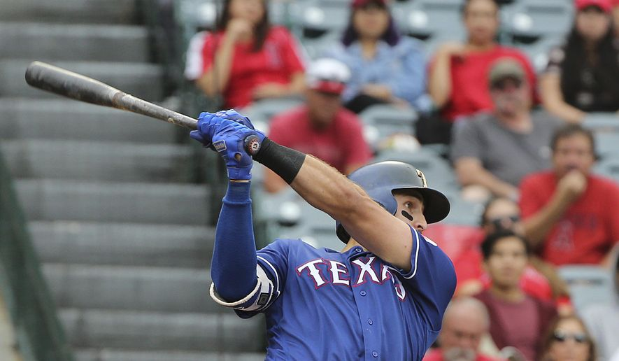 Texas Rangers' Joey Gallo connects on a solo home run against the Los Angeles Angels in the second inning of a baseball game in Anaheim, Calif., Sunday, Sept. 17, 2017. (AP Photo/Reed Saxon)