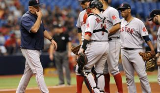 From left to right, Boston Red Sox pitching coach Carl Willis walks to the mound to talk with Xander Bogaerts, Christian Vazquez, starter Eduardo Rodriguez and Rafael Devers during the fifth inning of a baseball game against the Tampa Bay Rays, Sunday, Sept. 17, 2017, in St. Petersburg, Fla. (AP Photo/Steve Nesius)