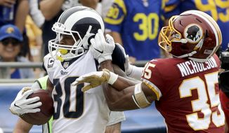 Los Angeles Rams running back Todd Gurley, left, is tackled by Washington Redskins safety Montae Nicholson during the first half of an NFL football game Sunday, Sept. 17, 2017, in Los Angeles. (AP Photo/Jae C. Hong) **FILE**
