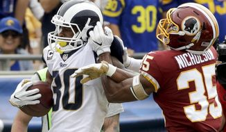 Los Angeles Rams running back Todd Gurley, left, is tackled by Washington Redskins safety Montae Nicholson during the first half of an NFL football game Sunday, Sept. 17, 2017, in Los Angeles. (AP Photo/Jae C. Hong)