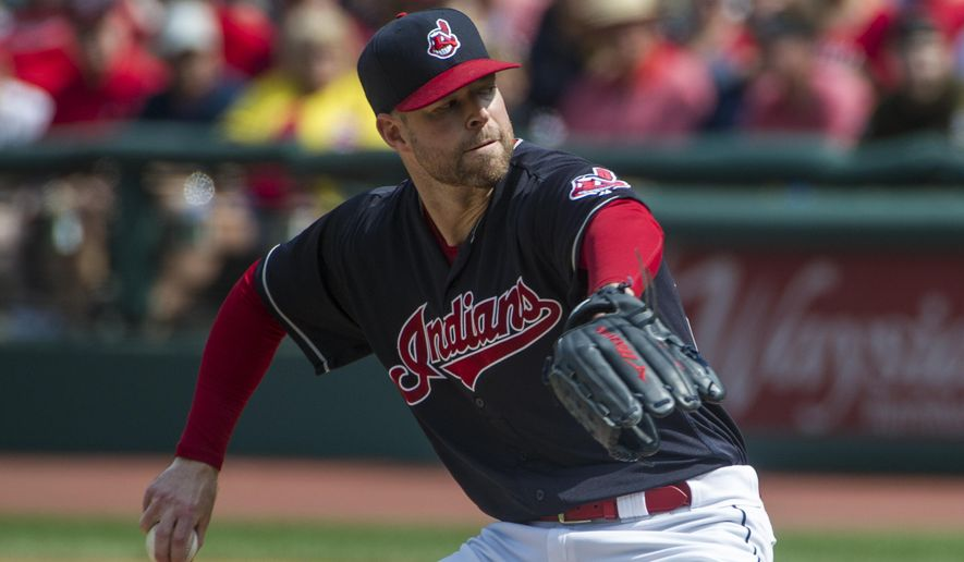 Cleveland Indians starting pitcher Corey Kluber delivers to Kansas City Royals' during the first inning of a baseball game in Cleveland, Sunday, Sept. 17, 2017. (AP Photo/Phil Long)