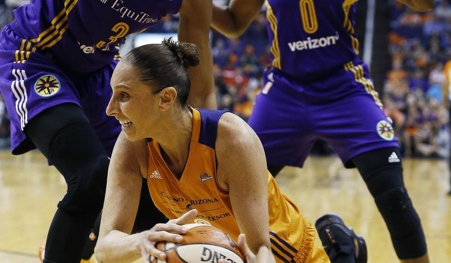 Phoenix Mercury's Diana Taurasi, middle, tries to get off a pass as Los Angeles Sparks' Candace Parker (3) and Alana Beard (0) defend during the first half of Game 3 of a WNBA basketball playoff semifinal Sunday, Sept. 17, 2017, in Phoenix. (AP Photo/Ross D. Franklin)
