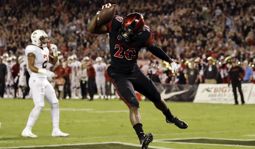 San Diego State running back Rashaad Penny reacts after scoring a touchdown during the first half of an NCAA college football game against Stanford on Saturday, Sept. 16, 2017, in San Diego. (AP Photo/Gregory Bull)