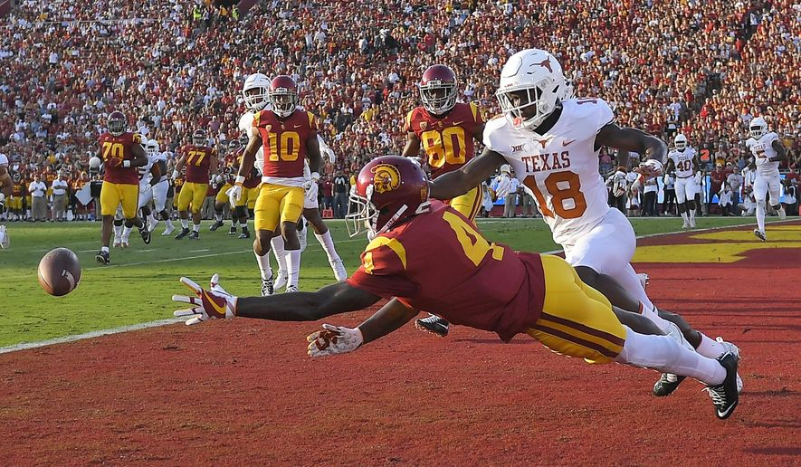 Southern California wide receiver Steven Mitchell Jr. left, can't reach a pass intended for him while under pressure from Texas defensive back Davante Davis during the first half of an NCAA college football game, Saturday, Sept. 16, 2017, in Los Angeles. (AP Photo/Mark J. Terrill)