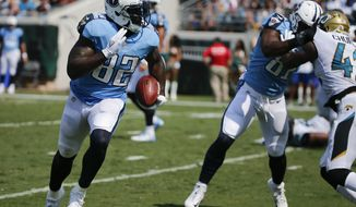 Tennessee Titans tight end Delanie Walker (82) rushes for a 1-yard touchdown against the Jacksonville Jaguars during the second half of an NFL football game, Sunday, Sept. 17, 2017, in Jacksonville, Fla. (AP Photo/Stephen B. Morton)