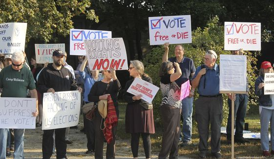 Protesters gathered on Tuesday in Manchester, New Hampshire, ahead of a daylong meeting of the Trump administration's election integrity commission. They argue that the commission, which is tasked with investigating voter fraud, is a sham. (Associated Press)