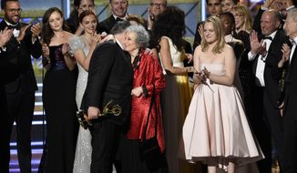 "Bruce Miller, from left, Margaret Atwood, and Elisabeth Moss accept the award for outstanding drama series for ""The Handmaid's Tale"" at the 69th Primetime Emmy Awards on Sunday, Sept. 17, 2017, at the Microsoft Theater in Los Angeles. (Photo by Chris Pizzello/Invision/AP) ** FILE **"