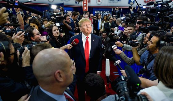 President Trump's relationship with the press has not changed much since this encounter then-candidate Trump had with reporters. (Associated Press)