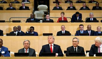"President Trump participated in a photo before the beginning of the ""Reforming the United Nations: Management, Security, and Development"" meeting during the United Nations General Assembly in New York on Monday. (Associated Press)"