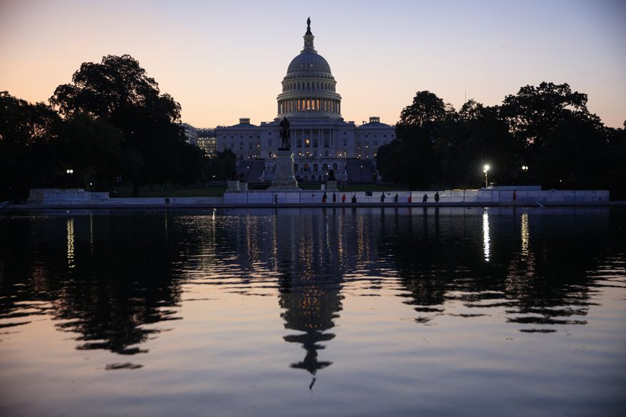 The Capitol is seen at sunrise as Congress returns from the August recess to face work on immigration, the debt limit, funding the government, and help for victims of Hurricane Harvey, in Washington, Tuesday, Sept. 5, 2017. (AP Photo/J. Scott Applewhite)