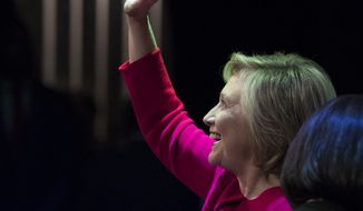 """Hillary Clinton waves to the audience at the Warner Theatre in Washington, Monday, Sept. 18, 2017, for book tour event for her new book """"What Happened"""" hosted by the Politics and Prose Bookstore. (AP Photo/Carolyn Kaster)"""