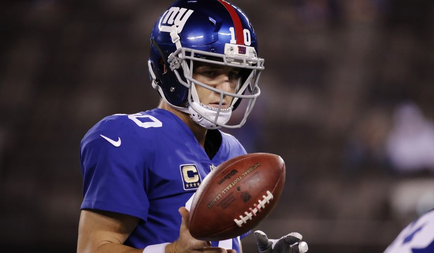 New York Giants' Eli Manning warms up before an NFL football game against the Detroit Lions Monday, Sept. 18, 2017, in East Rutherford, N.J. (AP Photo/Julio Cortez)